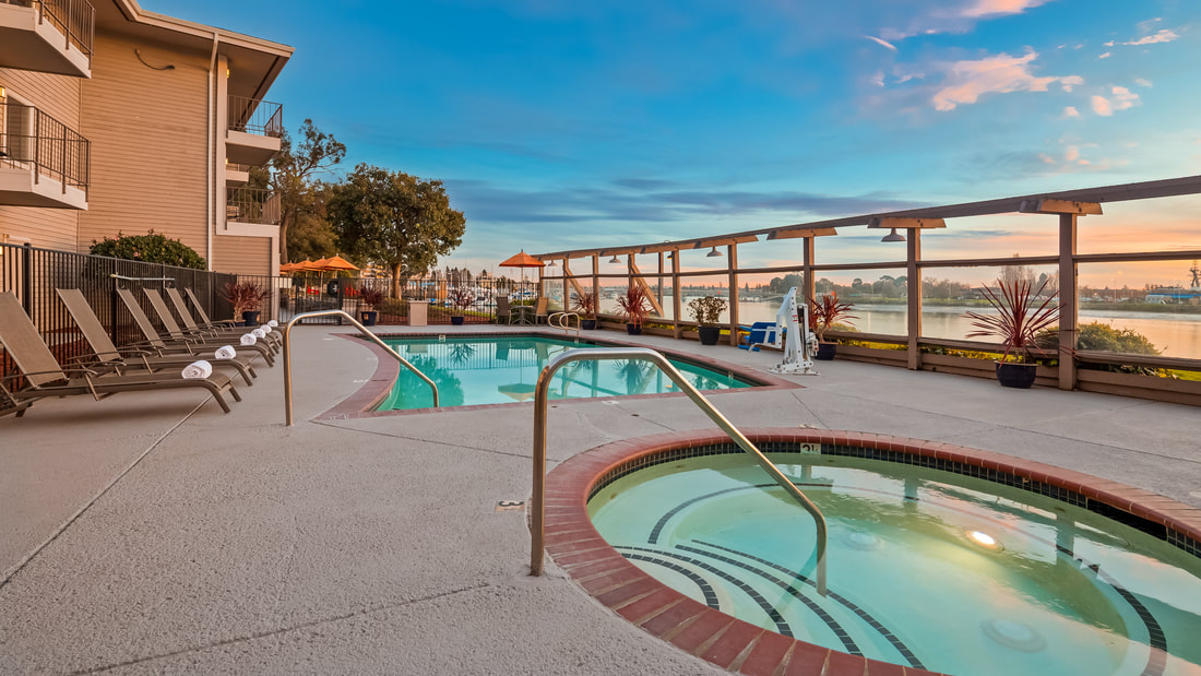 A Beautiful View of the Heated Pool and Jacuzzi at Executive Inn & Suites and Best Western Plus Bayside Hotel